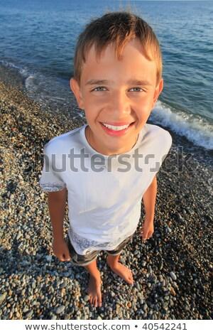 smiling teenager boy standing on seacoast Stock photo © Paha_L