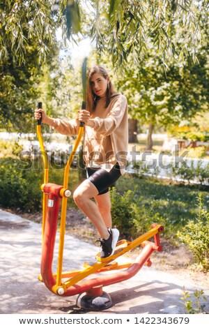 Mosolyog lány bicikli képzés apparátus szabadtér Stock fotó © Paha_L