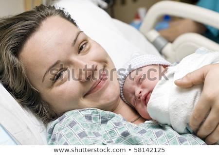 Сток-фото: Portrait Of A Newborn Baby Girl In Maternal Hospital