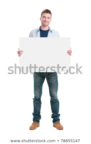 smiling young man holding a blank board  Stock photo © feedough