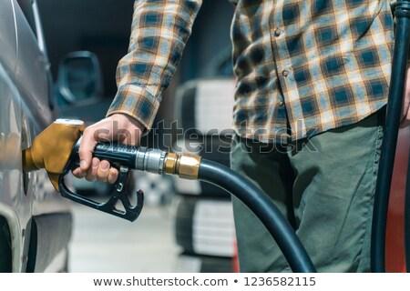 nő · olaj · hordó · benzinkút · pumpa · fúvóka · áll - stock fotó © rastudio