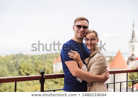 Happy young couple embraces against view of the city Stock photo © artfotodima
