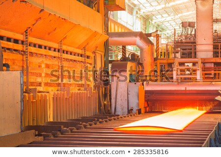 Hot plate on industrial conveyor Stock photo © mady70