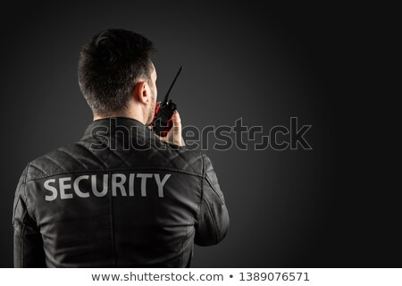 male security guard using walkie talkie stock photo © andreypopov