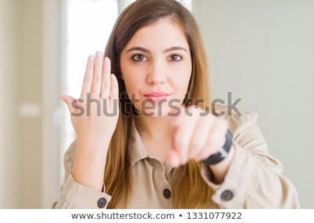 young beautiful bride pointing finger at you stock photo © deandrobot