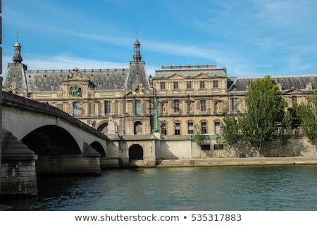 louvre museum pavillon de flore and seine river paris stock photo © photooiasson