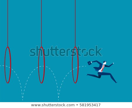 A man jumping through the hoops Stock photo © bluering