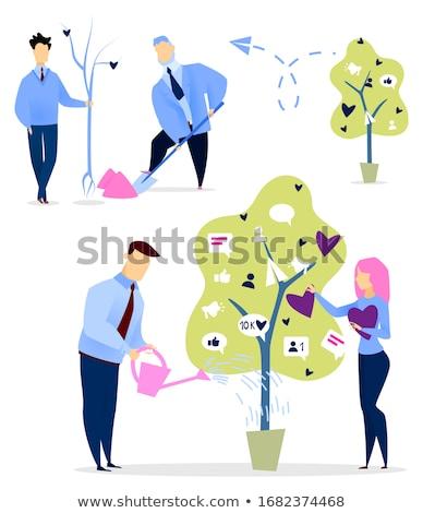 Férfi locsol fa növekvő edény szélturbina Stock fotó © RAStudio
