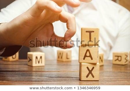 Imposto estresse tributação símbolo grupo texto Foto stock © Lightsource