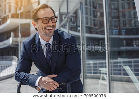 Happy Business man outdoors Stock photo © deandrobot