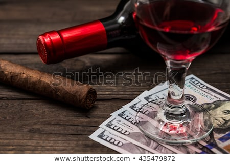 Luxury Cuban cigars and money on the wooden desk Stock photo © CaptureLight