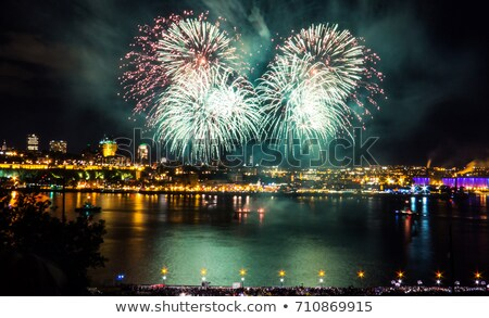 Stock photo: Golden red green fireworks over night sky