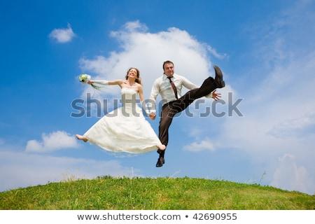 жених невеста прыжки красивой небе Сток-фото © tekso