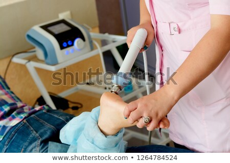 Physiotherapist injecting girl patient Stock photo © wavebreak_media