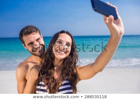mulher · maiô · pessoas · tecnologia · verão - foto stock © dolgachov