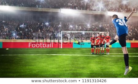 Futbolista toma pena tiro suelo hierba Foto stock © wavebreak_media