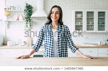 beautiful caucasian woman in the kitchen Stock photo © Nobilior