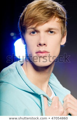 Serious intense young blond man Stock photo © Giulio_Fornasar