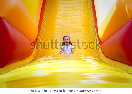 Children playing slide and bouncing on trampoline Stock photo © bluering