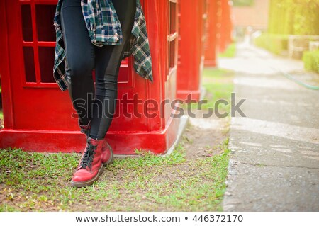 retro phone and womens red shoes stock photo © studiostoks