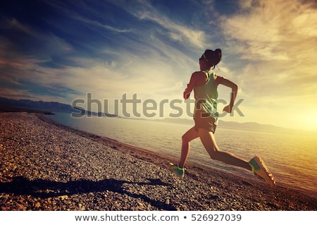 young woman runner running on trail in the morning stock photo © vlad_star