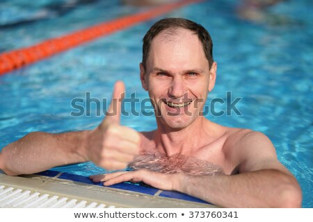 Male giving thumb up by outdoor swimming pool Stock photo © stevanovicigor