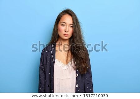 portret · jonge · brunette · schoonheid · groene · muur - stockfoto © bezikus