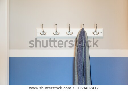 Wall in House with Scarf Hanging on Coat Rack Hooks Abstract Stock photo © feverpitch