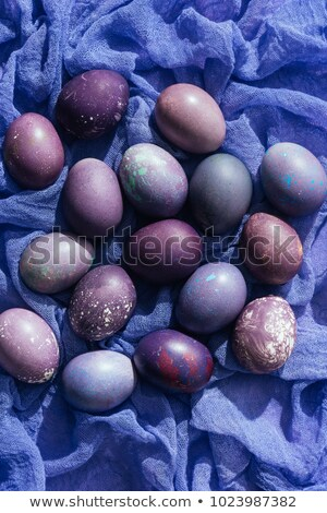 Stock photo: close up view of easter eggs on gauze, on purple
