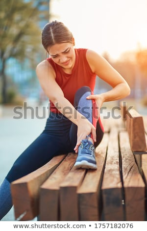 Pretty young sportswoman working out Stock photo © deandrobot