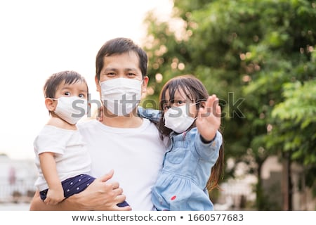 Father Holding His Daughter's Hand Stock photo © AndreyPopov
