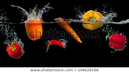 Wet ripe tomatoes and chili pepper Stock photo © dash