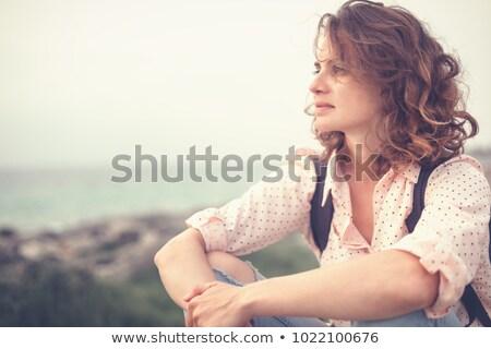 portrait of young thoughtful woman stock photo © acidgrey