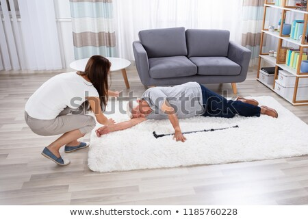 Unconscious Senior Man Lying On Carpet Stock photo © AndreyPopov