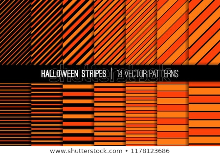 two vector pumpkins on the striped background stock photo © tasipas