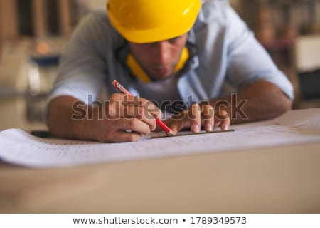 carpenters with ruler and blueprint at workshop Stock photo © dolgachov