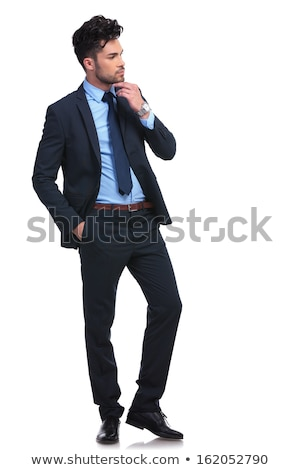 young elegant smart man thinks and looks to side  Stock photo © feedough