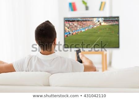 Man kijken voetbal wedstrijd televisie geschokt Stockfoto © AndreyPopov