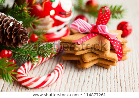 Christmas sweets composition. Gingerbread cookies with xmas decorations Stock photo © dash