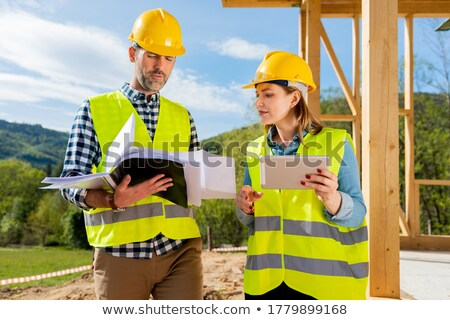 Stock photo: Supervisor Showing Building Plans To Workers In New House