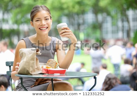 happy businesswomen eating take out food at office Stock photo © dolgachov