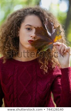 вьющиеся волосы подростка девушка Maple Leaf осень лес Сток-фото © boggy