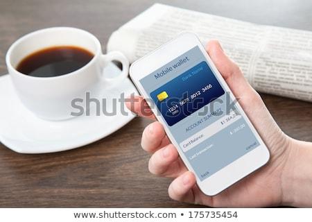 winkelwagen · hand · munt · witte · business · achtergrond - stockfoto © andreypopov