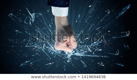 Hand hits intense and breaks glasses Stock photo © ra2studio