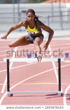 Portrait of a focused young african sportswoman Stock photo © deandrobot