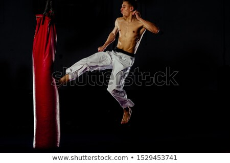 a man in a high jump beats a kick stock photo © andreyfire