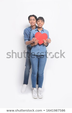 full body picture of a casual couple sharing big heart stock photo © feedough