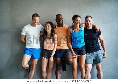 Znajomych odzież sportowa mówić wraz stałego siłowni Zdjęcia stock © boggy