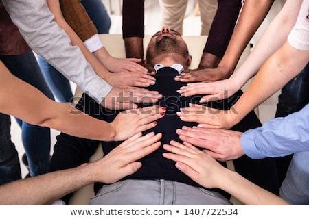 Groep handen aanraken lichaam tabel reiki Stockfoto © AndreyPopov