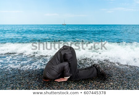 Unsuccessful Businessman Burying His Head In The Sand Stock photo © AndreyPopov